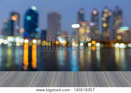 Opening wooden floor Blurred bokeh light blue twilight sky over office building and reflection abstract background