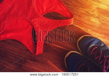 Sports and fitness accessories: sneakers and sports bra. Healthy lifestyle concept.