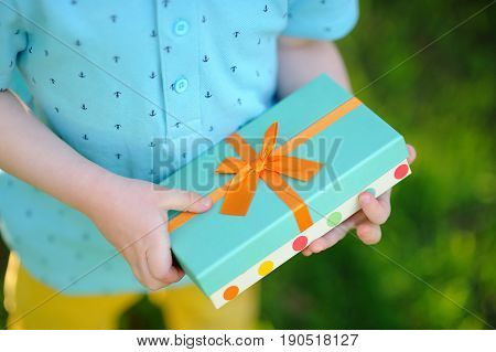Close-up Of Nicely Wrapped Birthday Gift Being Held By A Child