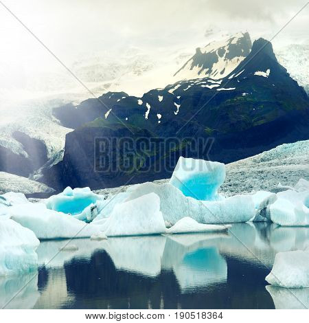 Icebergs floating in Jokulsarlon glacier lagoon with sun shine