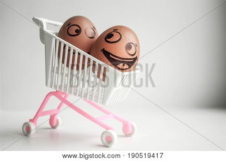 Buy Basket Concept. An Egg With A Painted Face
