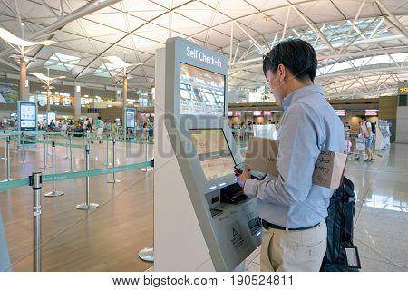 SEOUL, SOUTH KOREA - CIRCA JUNE, 2017: man uses self check-in kiosk at Incheon International Airport.