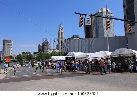 COLUMBUS, OHIO - JUNE 9, 2017:  The Columbus Arts festival attracts approximately 450,000 visitors downtown to the riverfront and along the Main Street and Rich Street Bridges.