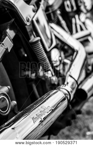 PAAREN IM GLIEN GERMANY - JUNE 03 2017: Exhaust pipes of a motorcycle Harley-Davidson. Black and white. Exhibition