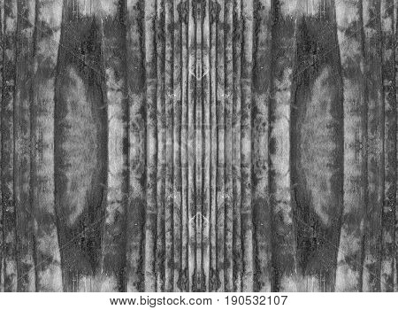 The burnt surface of a wooden table with black and white shades of color
