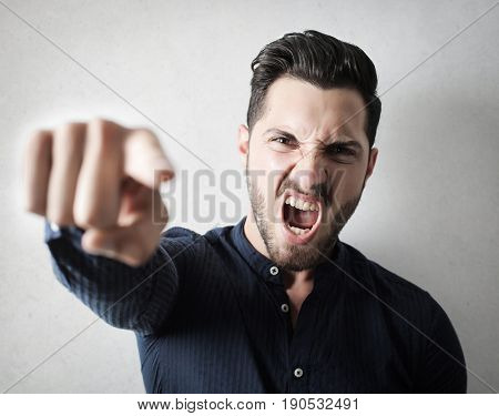 Angry man pointing his finger and shouting