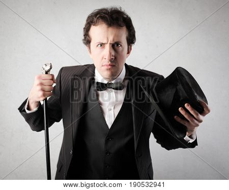 Angry gentleman with top hat and walking stick