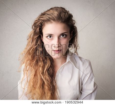 Long-haired woman looking straight into the camera
