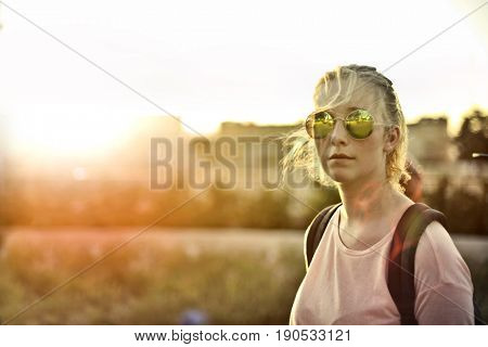 Fashionable teenager wearing stylish sunglasses