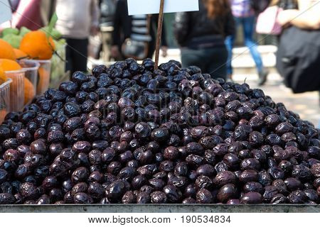 Olives on a street cart market in Athens, Greece. Concept for travel, urban and street life, fresh, healthy, raw, easy accessible food and small family business