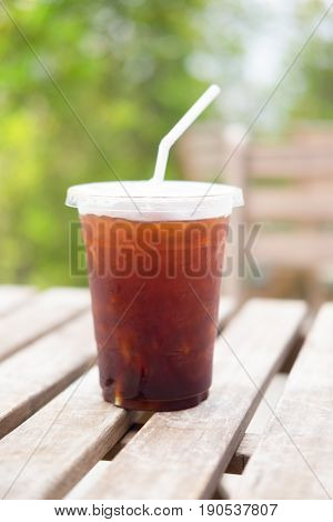 Ice of americano with coffee cafe shop blur background