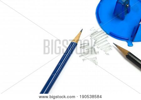 blue wooden pencil sharpener and pencil shavings on white