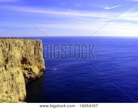 Majestic cliffs looking down on deep blue ocean