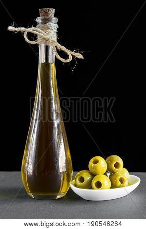Extra Virgin Olive Oil And Pitted Green Olives