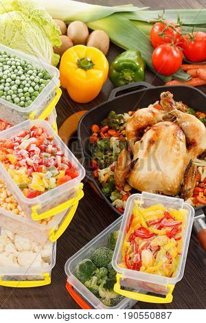 Roasting frozen vegetables in plastic containers roasted chicken in pan. Healthy freezer food.