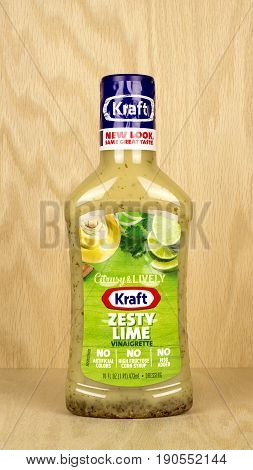 RIVER FALLS,WISCONSIN-MAY 10,2017: A bottle of Kraft brand Zesty Lime dressing with a wood background.
