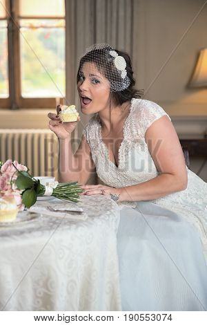 Cheeky Bride Is About To Take A Bit Out Of A Cup Cake