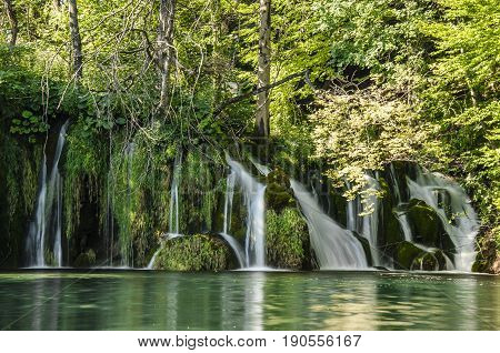 landscape with waterfall of plitvicka lake national park at sunset silky stream of water unesco heritage site plitivce croatia.