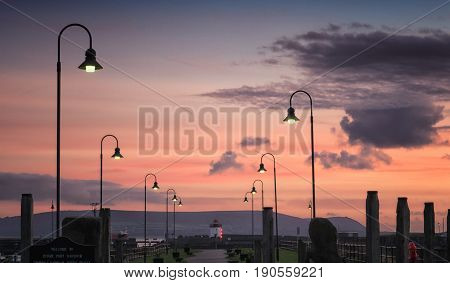 View to Burry Port lighthouse at twilight near Llanelli Carmarthenshire Wales.