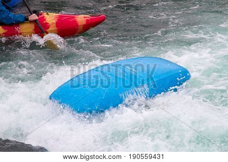Capsized Kayak In Rough Water