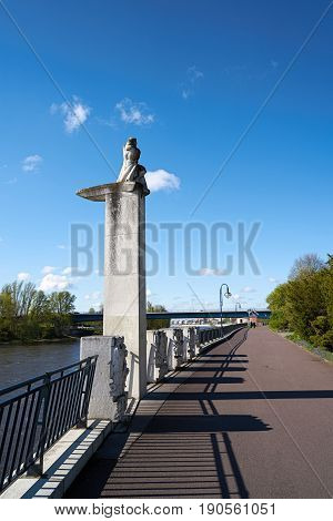 MAGDEBURG, GERMANY - APRIL 19, 2017: Promenade on the bank of the river Elbe in Magdeburg with the monument