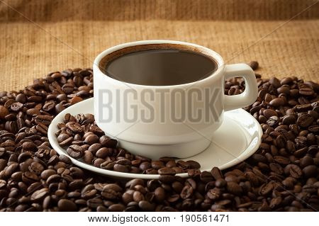 Coffee In White Cup On Fabric Background.