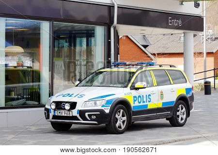 Vagnharad, Sweden - April 22 2017: One parked Volvo Swedish police car outside the police station at the town square.