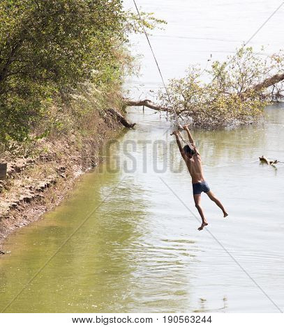 man on the bungee on the river