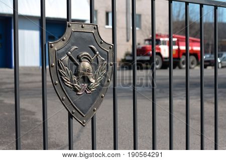 Murmansk, Russia - May 25, 2010: Emblem of the State Fire Service at the gate of the fire station Murmansk
