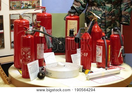 Murmansk, Russia - May 25, 2010: Fire extinguishers of different models are on the table