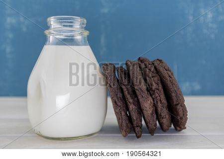 Double Chocolate Cookies Lean Against White Milk