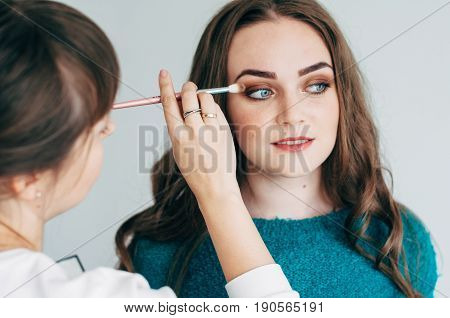 Make-up Artist Does The Make-up Of The Girl