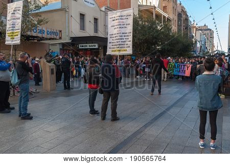 Adelaide, AU, Australia - June 10, 2017: South Australians encounter religious opposition in Rundle Mall as they protest Trump`s support for laws discriminating against LGBTI people in the name of religious freedom.