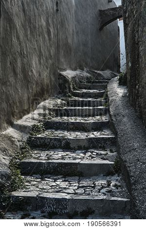 Medieval street and stone stairs in the city of Lindos on the island of Rhodes