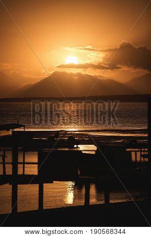 Ilha Do Mel Paraná Brazil - June 3 2017: Sunset behind the mountain in the Honey Island.