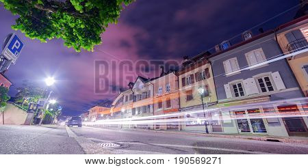 Lutry, Switzerland. 4th June 2017. Nightfall in the quiet streets and lanes of Lutry just outside Lausanne in Switzerland.  Cars are passing along the street, captured as lights trails.