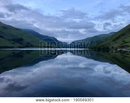 Tal-y-lynn glacial ribbon lake at dusk in Snowdonia National Park, Wales