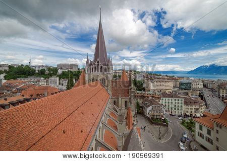 Lausanne cityscape skyline on a partly sunny, partly cloudy day