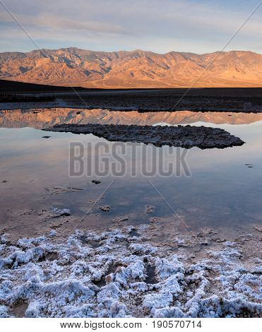 Salt deposits in foreground at Badwater along with the Panamint Mountains in the background