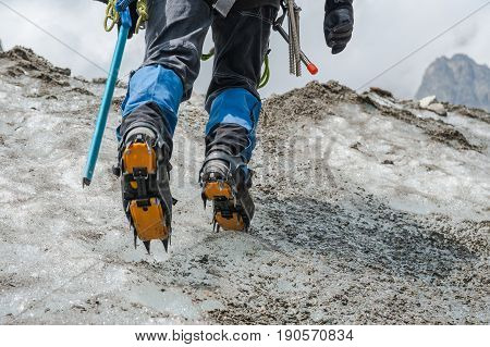 Alpinist climbing on glacier extremal sport in mountain