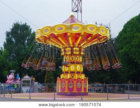 A Vibrant And Colourful Vintage Carousel At A Fairground