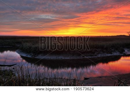 Sunset on a salt marsh near the Saint Mary`s River in Saint Mary`s, Georgia.