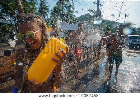 14 April 2016, Kho Phangan, Thailand. Young woman with water gun has a fun
