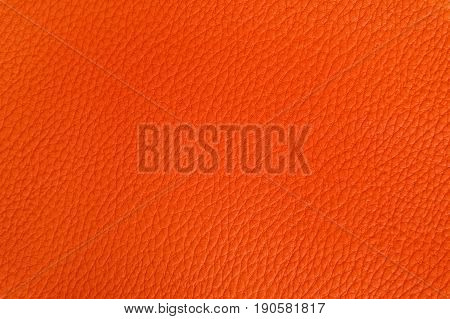 Background image of the texture of the leather painted in orange.