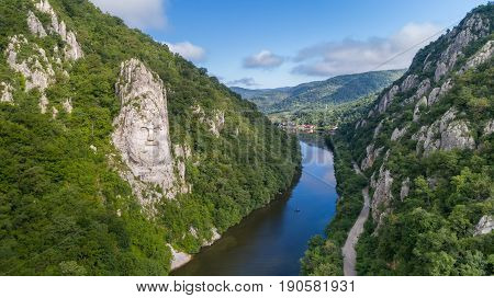 Decebal Head sculpted in rock Danube Gorges (Cazanele Dunarii) Romania. Aerial view.