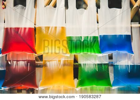 Background from color water in plastic bag.