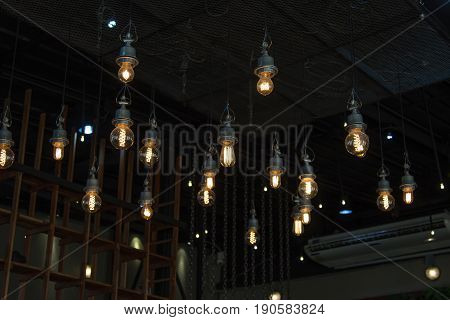 Lighting On The Chandelier In The Lamplight And Light Bulbs Hanging From The Ceiling Or Lamps On The