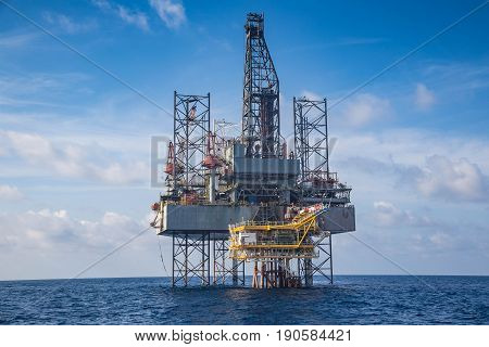 Offshore oil and gas drilling rig at the gulf of Thailand whil compleation on wellhead remote platform.