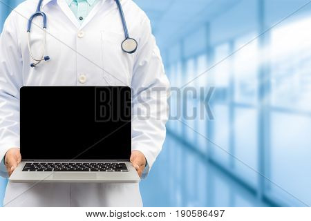 Doctor Holding Laptop Computer In Front View