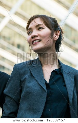Business woman standing turning face upwards with confidence. Concept of confident business woman woman leadership.